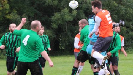 New Greens' defence come under pressure from a Player Packs forward. Picture: BRIAN HUBBALL