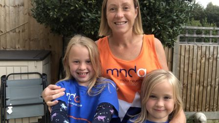 Catherine Everett, pictured here with her daughters Anna and Evie, has run 128 miles for the Motor Neurone Disease...