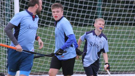 Harry Pybus (right) scores for St Neots Hockey Club fourth team. Picture: HELEN ROWLAND