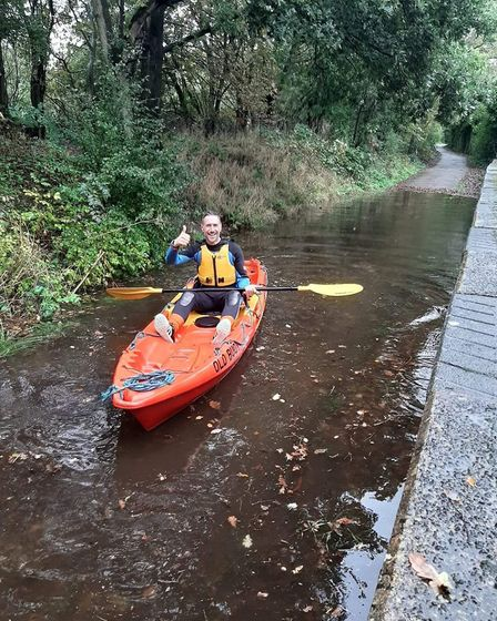 Keep calm and paddle on: Mike came to the rescue of stranded marathon runners in his kayak. Picture: Oliver Cassidy