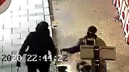 CCTV images of the men police want to talk to in connection with a burglary in St Ives.