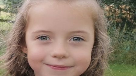 Eight-year-old Jessica Joy had to be saved by dad Garry from falling into an open drain which was flooded in Royston.