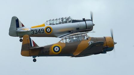 A Yale and a North American Harvard Mk.IV, nicknamed Wacky Wabbit, flying together at the IWM Duxford Showcase Day on...