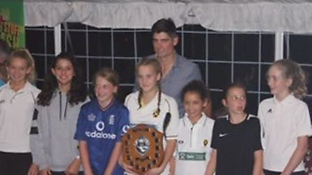 St Albans Cricket Club's U12 girls team with Alistair Cook in 2017.