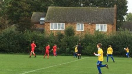 Hemingford Colts in action against March Town Reds. Picture: SPENCER O'LEARY