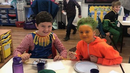 Kai Bilton and Max Barrett (Year 4) enjoying their harvest breakfast.Picture: Therfield First School
