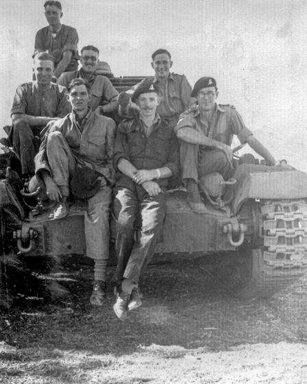 Captain Sir Tom Moore pictured with an armoured vehicle and fellow soldiers. Picture: The Captain Tom Foundation