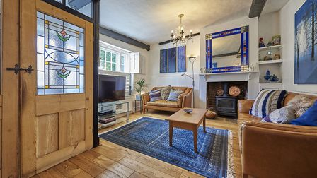 The front door opens into the living room, which has a gas-fired, cast iron feature fireplace. Picture: Frosts's
