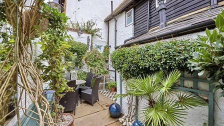 There is a private courtyard garden to the rear. Picture: Frosts's