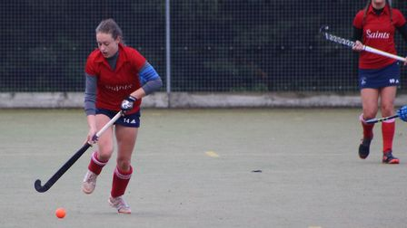 Caz Osborne in action for St Neots Hockey Club as Charlie Churms looks on. Picture: SNHC