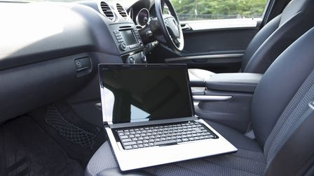 A laptop and a comfy car seat is all that's needed for some workers. Picture: Getty Images/iStockphoto