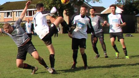 Hilltop (white) defend against Phoenix in their Herts Ad Sunday League Premier Division match. Picture: BRIAN HUBBALL