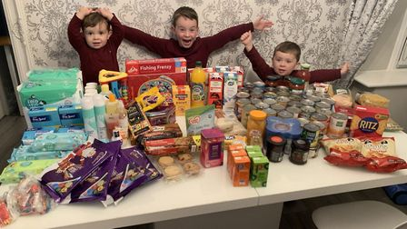 Teddie, Bertie and Percy pose with their collection. Picture: Louisa Sandford