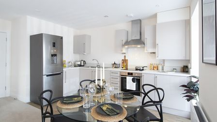 The apartments feature modern kitchen and dining areas. Photo: Stuart Thomas