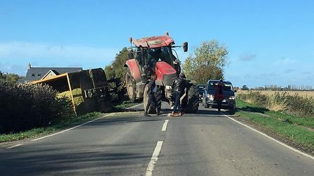 Guyhirn to Murrow road was blocked after a tractor and trailer came off the road - closely followed by another. Picture;