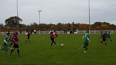 New signing Aaron Murrell in action for Huntingdon Town against Burton Park Wanderers.