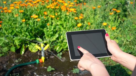 Smart garden technology can water your plants and mow the lawn, even when youre away. Picture: PA Photo/iStock