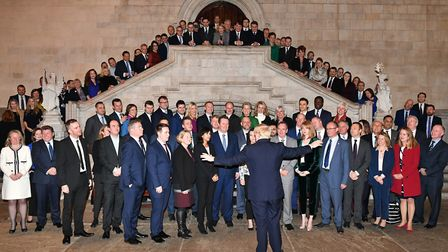 Boris Johnson alongside the newly elected Conservative MPs at the Houses of Parliament in Westminste