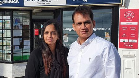 Tayyab and Nushaba Mahmood outside the post office and stores in Hartford.