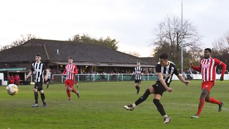 George Devine scores for Colney Heath against New Salamis in the FA Vase match at the Recreation Ground. Picture: JAMES...