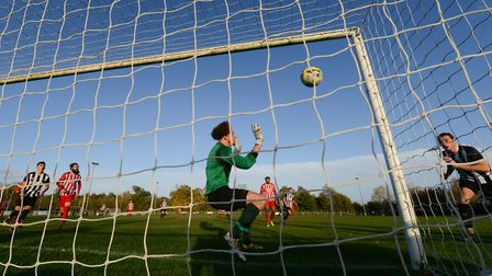Max Jessop scores for Colney Heath against New Salamis in the FA Vase match at the Recreation Ground. Picture: JAMES LATTER