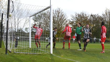 Yasin Boodhoo scores for Colney Heath against New Salamis in the FA Vase match at the Recreation Ground. Picture: JAMES...