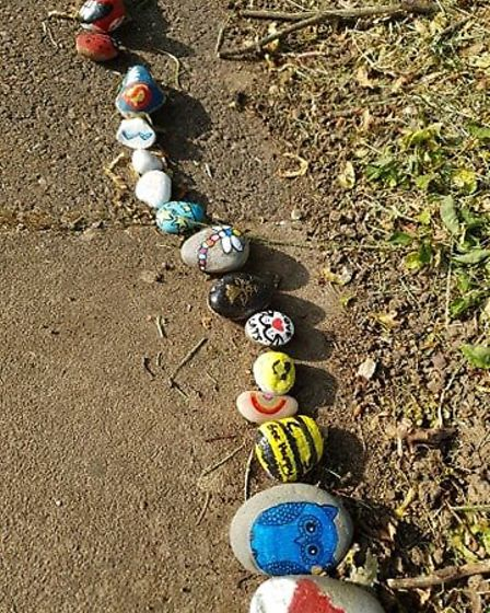 People of all ages have added brightly-painted stones to Covid the Cobra on Stevenage's Grace Way. Picture: Dawn Parnell