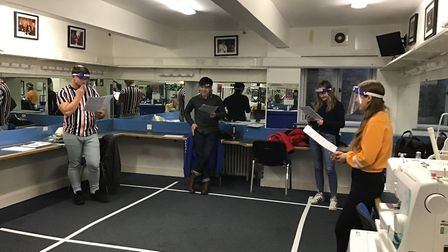 Dan Ellis, Nathan Galpin, Sophie Craddock, and Nicole Tilby rehearsing a socially distanced group scene as their...