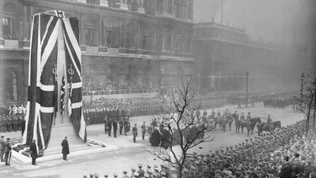 A gun carriage bearing the coffin of the Unknown Warrior arrives at the Cenotaph before its unveiling on November 11, 1920.