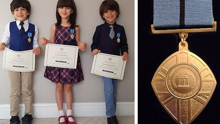Triplets from Walpole Highway have each received a 'British Citizen Youth Award' for their NSPCC fundraising efforts.