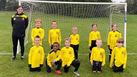 The newly-formed U7 team at Priory Parkside Football Club with coach Jodie Seamark.