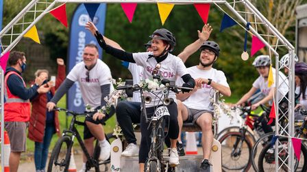 Heidi's sister challenge passing the finish line for Garden House Hospice Care. Picture: Martin Wooton