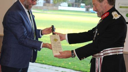 Chairman Antony Mauder receiving a commemorative bat from The Lord-Lieutenant of Hertfordshire, Robert Voss CBEPicture...