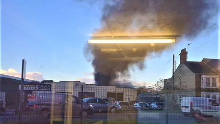 A fire has broken out at Wisbech Breakers garage on Weasenham Lane. Picture: Tara Rose