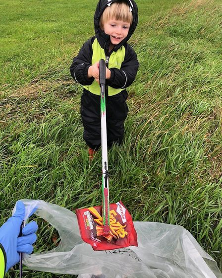 Daniel helping out at a previous Therfield Heath litter pick. Picture: Supplied