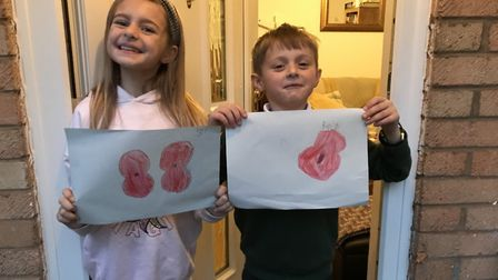 Ben and Lucy Davies drew poppies for the window for the RBL.