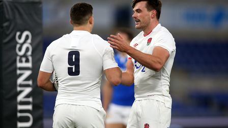 England's Ben Youngs (left) is congratulated by Huntingdon's George Furbank after his try in Rome. Picture: MARCO...