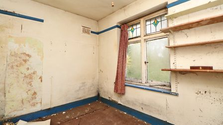 Original features include stained glass windows. Picture: Paul Barker Estate Agents