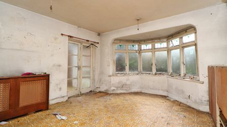 Doors connect the dining room to a lobby area, which leads to the garden room. Picture: Paul Barker Estate Agents