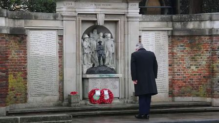 Sir Oliver Heald MP pays his respects at the Remembrance Sunday service at the war memorial led by Rev Heidi Huntley.