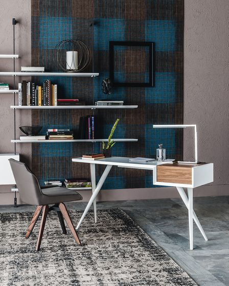 This Batik Desk By the luxury brand Cattelan Italia is marketed as being discreet and 'ideal for carving out a focus area'.