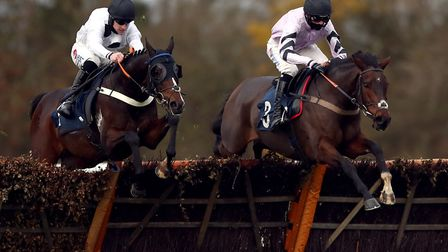Wild Max ridden by jockey Harry Cobden (right) clears a fence on the way to winning the Download The tote App Michaelmas...