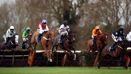 Runners and riders during the Download The tote App Michaelmas Handicap Hurdle at Huntingdon Racecourse. Picture: TIM...