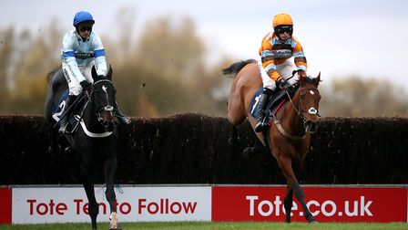 Master Tommytucker ridden by jockey Harry Cobden clears a fence on the way to winning the Download The tote App...
