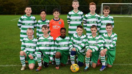 Huntingdon Town Rowdies, donning their newly-sponsored kits by Vistry East Midlands