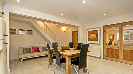 The eat-in kitchen opens onto an adjoining family room . Picture: Cassidy & Tate