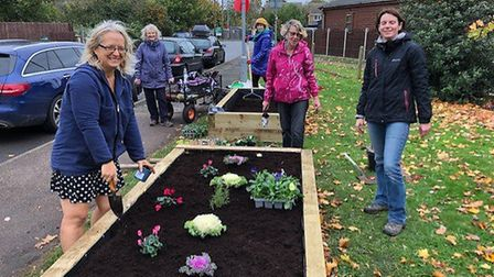 Volunteers planting the beds for the new community garden in Little Paxton.
