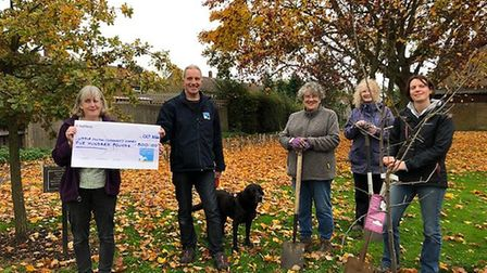 Volunteers in Little Paxton received funding for the new garden from Kingfisher Funerals.