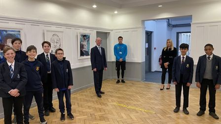 Mr Ramsey pictured with pupils from the current Years 8 and 9 and ex-pupils Ms C Johnson and Mr J Anthony who now teach at...