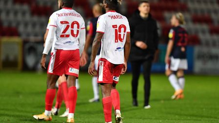 Femi Akinwande and Tyrone Marsh of Stevenage at the final whistle of their game with Bolton Wanderers. Picture: DAVID...